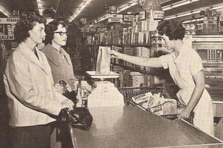 Market in Salem, Oregon, circa 1962. Smiles people! Smiles!